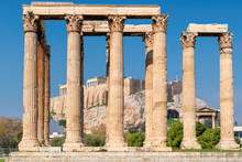 Olympian Zeus Temple And The Acropolis In Athens, Greece.
