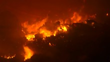 Bales Of Straw Burning And Smoking In A Farm,  It Will Take Several Days For The Fire To Die Out. Night.