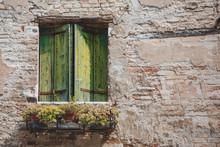 Window With Old Green Shutters Break Wall