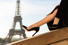 Paris Fashion. Dress, Shoes On High Heels On The Background Of The Eiffel Tower