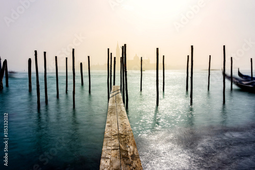 Fototapeta San Giorgio Maggiore church and wooden pier in Venice during a misty/foggy spring day, Venice, Italy. obraz