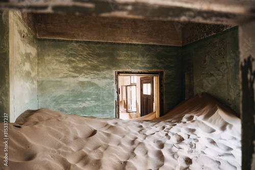 desert sand has invaded and taken over these rooms in Kolmanskoppe, Namibia Fototapeta