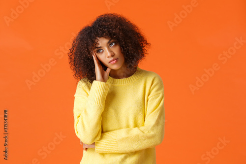 Uninterested bored african-american woman in yellow sweater, facepalm, looking a Canvas Print