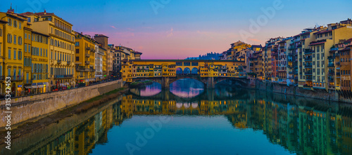 The Ponte Vecchio, famous medieval stone bridge over the Arno River in Florence, Tuscany, Italy Wallpaper Mural