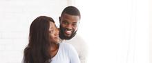 Young Joyful Married Couple Po...