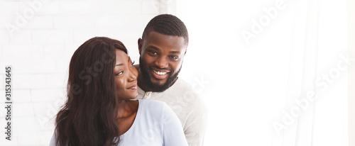 Obraz Young joyful married couple posing over white background - fototapety do salonu