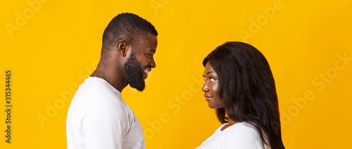 Black girl and guy looking at each other
