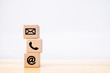 contact us icon (phone, email, mail ) on wood cube, customer service and support concept
