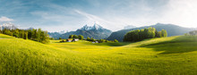 Idyllic Mountain Landscape In The Alps With Blooming Meadows In Springtime