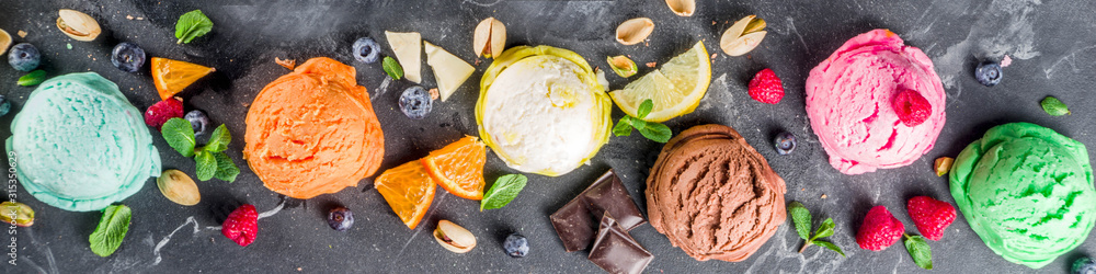 Obraz Colorful pastel ice cream with waffle cones and various flavor ingredients, black marble background, copy space top view fototapeta, plakat