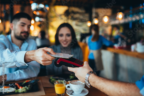 close up of man paying bill using mobile phone Tablou Canvas