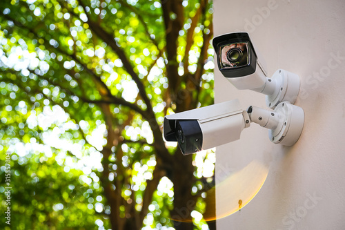 Fotografia Outdoor CCTV monitoring, security cameras with sunlight flare.
