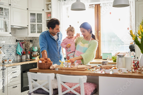 Happy family spending Easter together in the kitchen Canvas Print