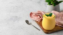 Yellow Mango Lassi On Gray Bac...