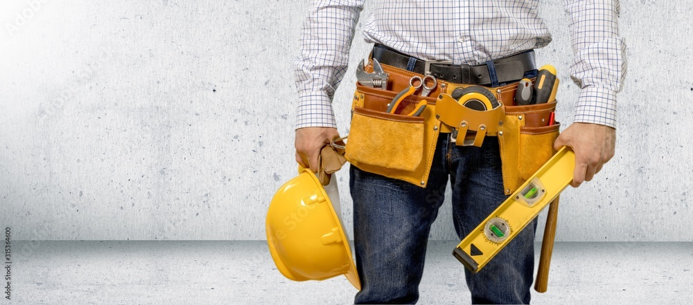 Fototapeta Man worker and professional builder with tools