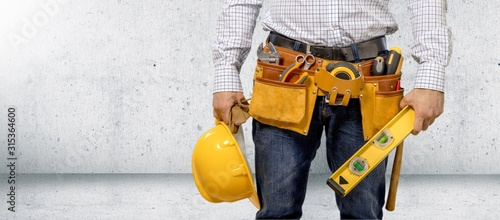 Man worker and professional builder with tools Fototapete