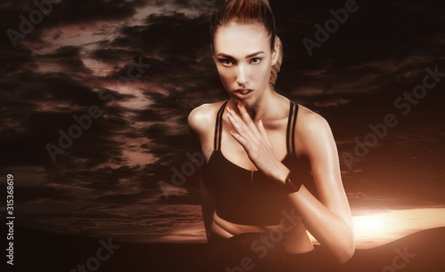 Fotomural  Athlete Woman Jogging Outdoor Over Sunset Time Sky