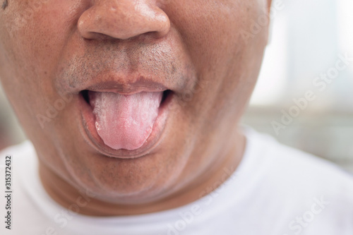 old man sticking out his tongue, concept of rude tongue out, making fun with ton Fototapet