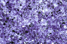 Abstract Background Of Close Up Detail Of Fragments Of Purple Crushed Glass