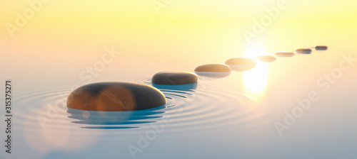 Row of stones in calm water in the wide ocean, meditation and zen concept image
