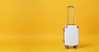canvas print picture - White luggage bag isolated on yellow banner background with copy space for advertisement..