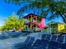 Colorful Tropical Cabanas Or Shelters On The Beach Of Half Moon Cay