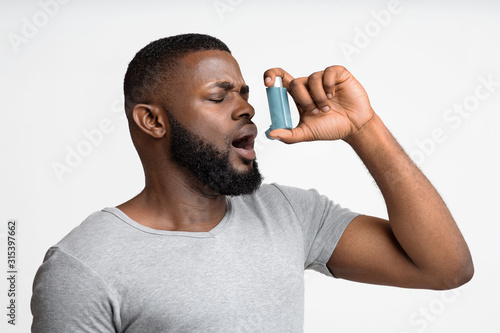 Picture of a young man having an asthma attack Canvas Print
