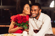 canvas print picture - Girlfriend Kissing Boyfriend After Receiving Roses During Date In Restaurant