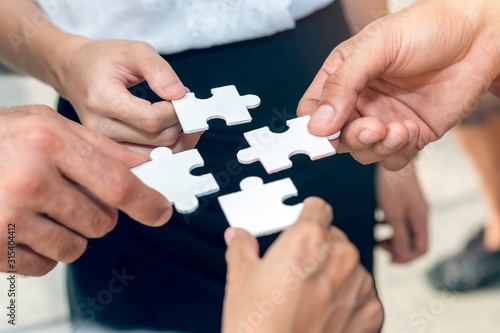 Fototapety, obrazy: Close-up ,Hand of business people holding jigsaw puzzle.