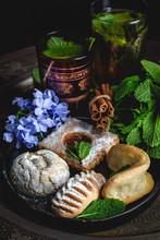 Traditional Tea With Mint And Assorted Homedade Arab Sweets On Dark Background. Ramadan. Islamic. Halal