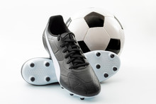 Competitive Team Sports, Active Life Hobbies And Athletic Gear Concept With Old-fashioned Black Leather Football Cleats Or Athletics Boots With Laces And Soccer Ball Isolated On White Background