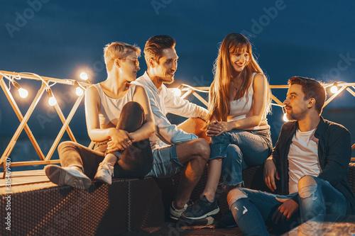 Fototapeta Group of friends enjoying outdoors at roof obraz