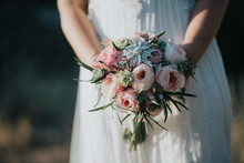 Crop Bride With Bouquet In For...