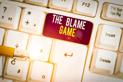 Text sign showing The Blame Game Wallpaper Mural