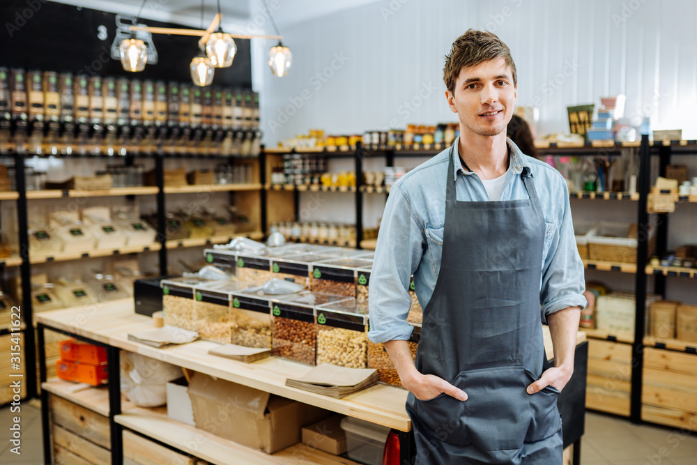 Fototapeta Portrait of young man owner over interior of Zero Waste Shop in Grocery Store. No plastic Conscious Minimalism