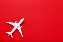 Airplane Model On Red Paper Ba...