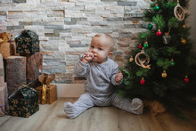 Cute Baby Playing With Christmas Tree Baubles