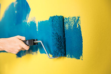 Man Painting Yellow Wall With Blue Dye, Closeup