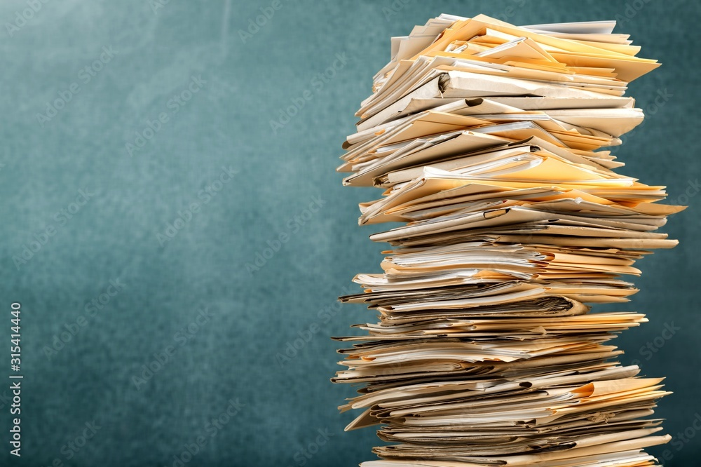 Fototapeta Stack file folders with documents on background