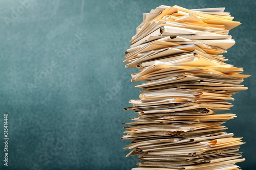 Stack file folders with documents on background