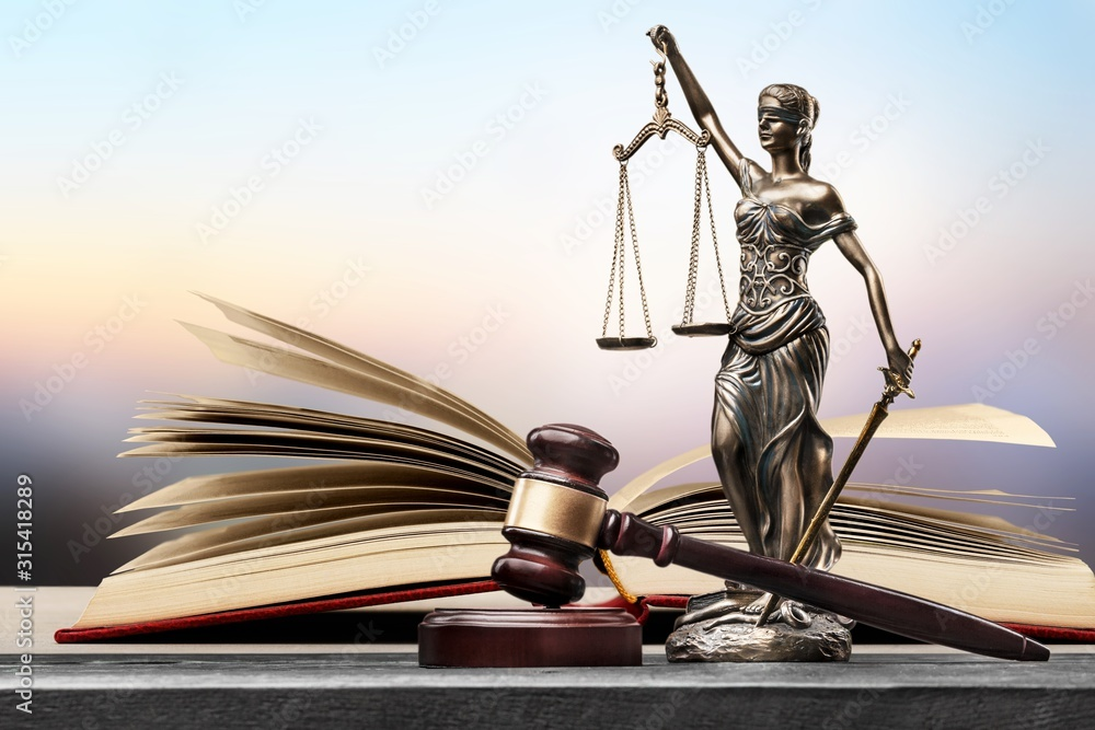 Fototapeta Sculpture justice bronze lady and open books and gavel