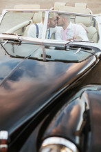 Elegant Gay Couple Kissing In A Vintage Convertible Car