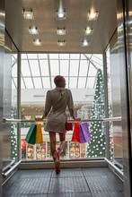 Woman With Colorful Shopping B...