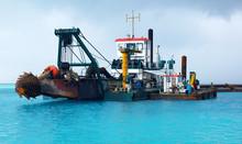 Dredger Heavy Excavator On Water In The Sea (Deep Sea Dredge)