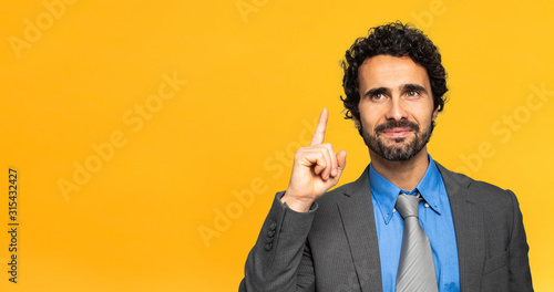 Obraz Young businessman having the solution on yellow background - fototapety do salonu
