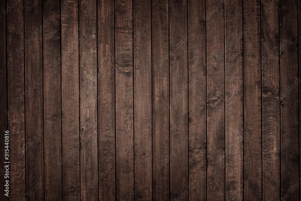 Fototapeta Textura de pranchas de madeira escura rústica envelhecida na vertical.