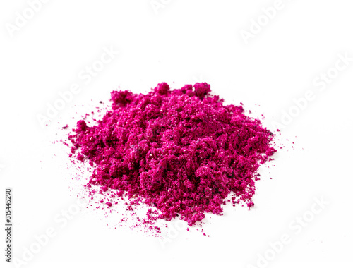 Fototapeta Dragon fruit powder heap isolated on white with clipping path. Perfect bright magenta freeze dried pitahaya cactus or Hylocereus costaricensis powder obraz