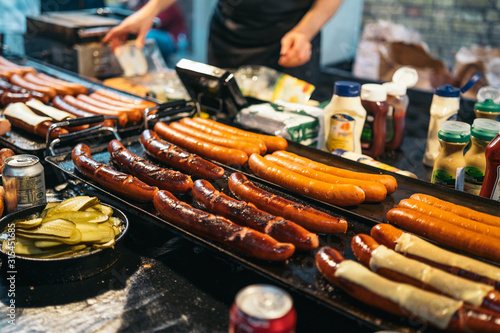 Foto Traditional BBQ barbeque wurst sausages on Christmas market in Germany in Europe in winter
