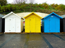 Three Beech Huts Beach Huts In Primary Colours On Lowestoft Sea Front.