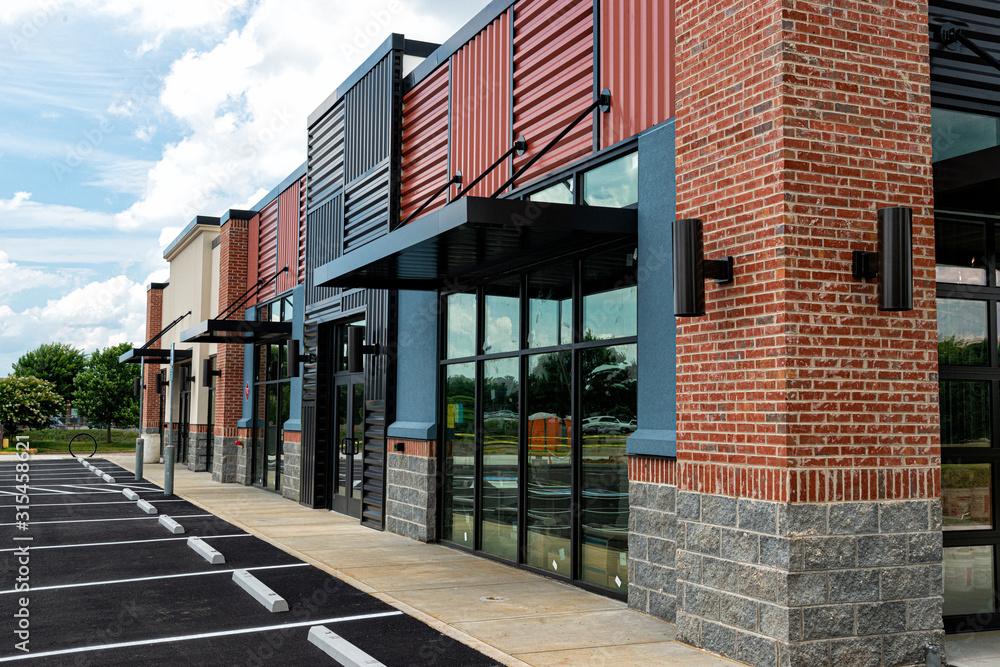Fototapeta New Shopping Strip Center Almost Ready to Open